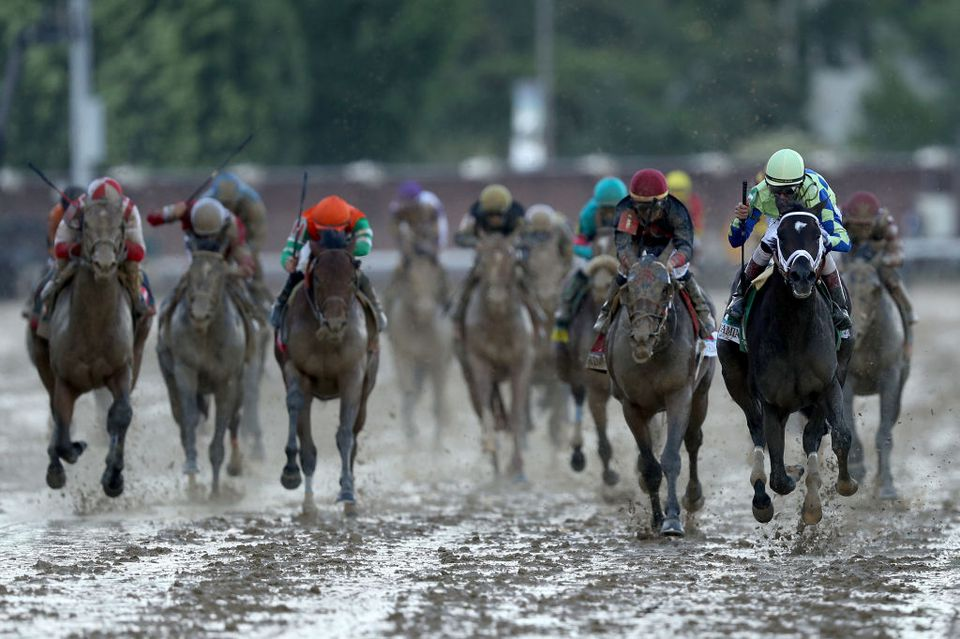 Jockey John Velazquez celebrates as he guides Always Dreaming #5 across the finish line to win the 143rd running of the Kentucky Derby at Churchill Downs on May 6, 2017 in Louisville, Kentucky.