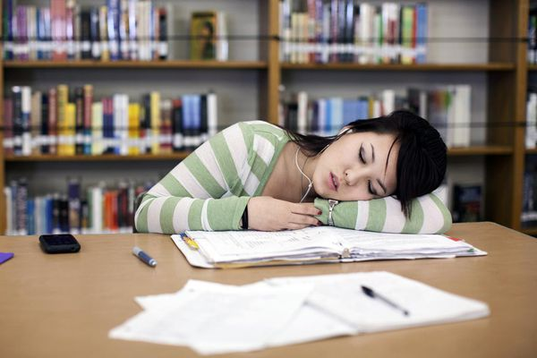 Teenage girl sleeping in school library