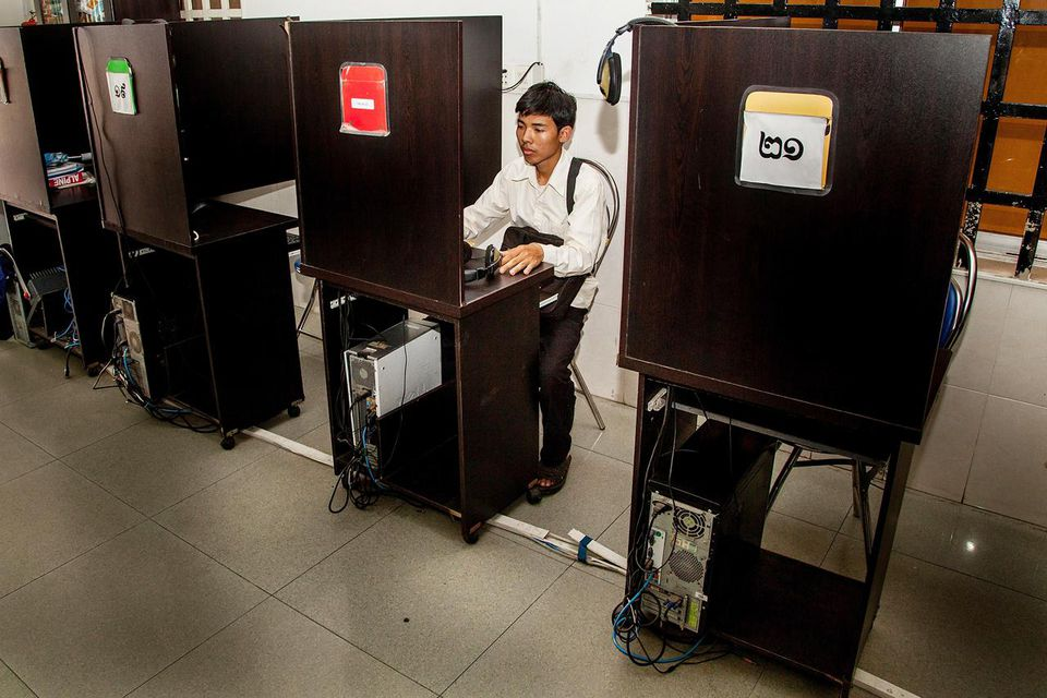 A young Cambodian checks social media from an internet cafe on April 9, 2014 in Phnom Penh, Cambodia.