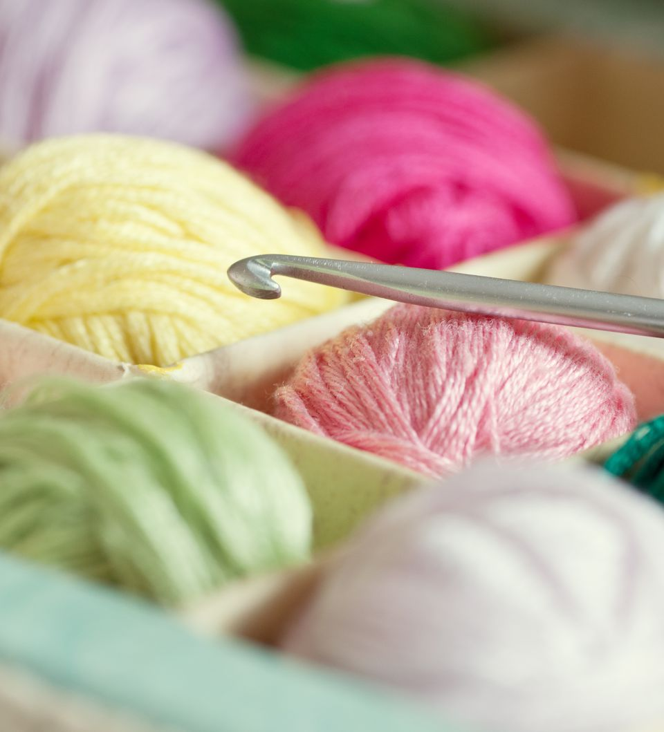 Crochet hook and colourful threads