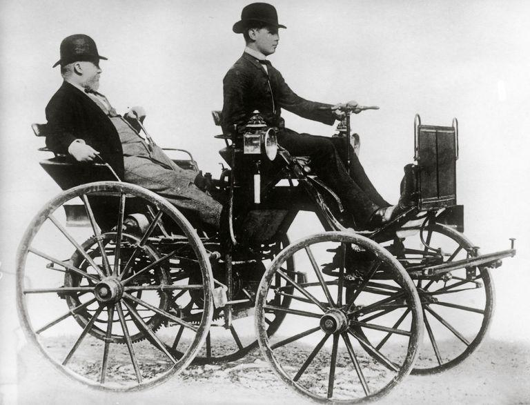Gottlieb Daimler sitting in a motor vehicle