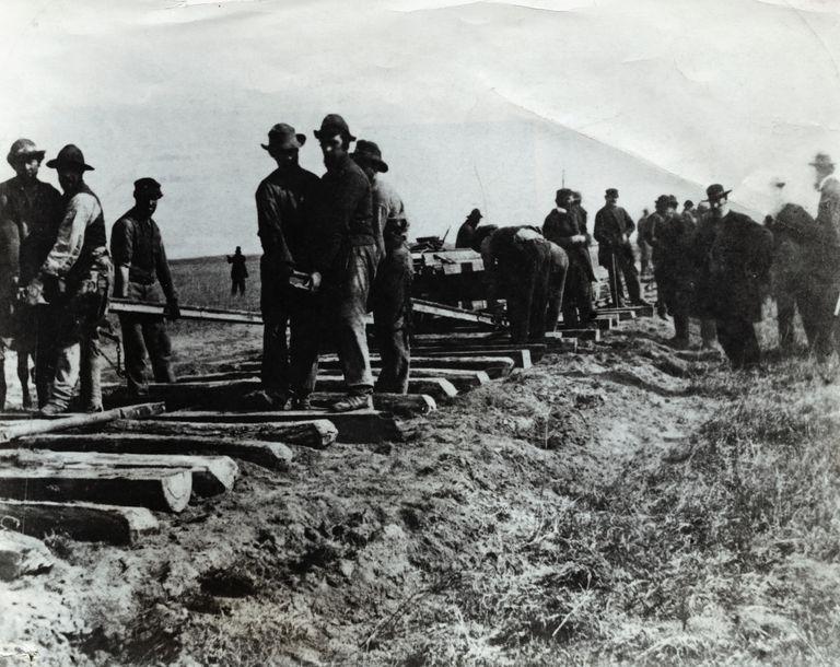 Men Laying Railroad Tracks