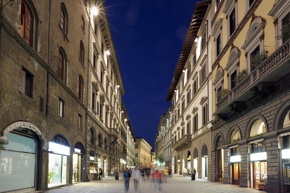 The 'Via dei Calzaiuoli' high street in Florence illuminated at night