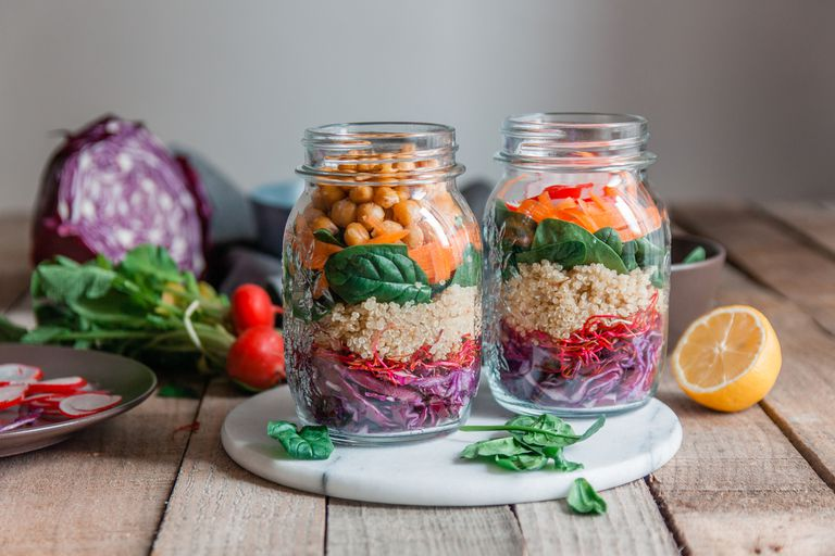 Colorful vegetables in jars