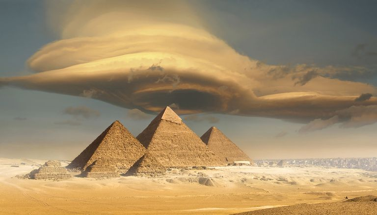 Dramatic storm cloud above pyramids, Giza, Egypt