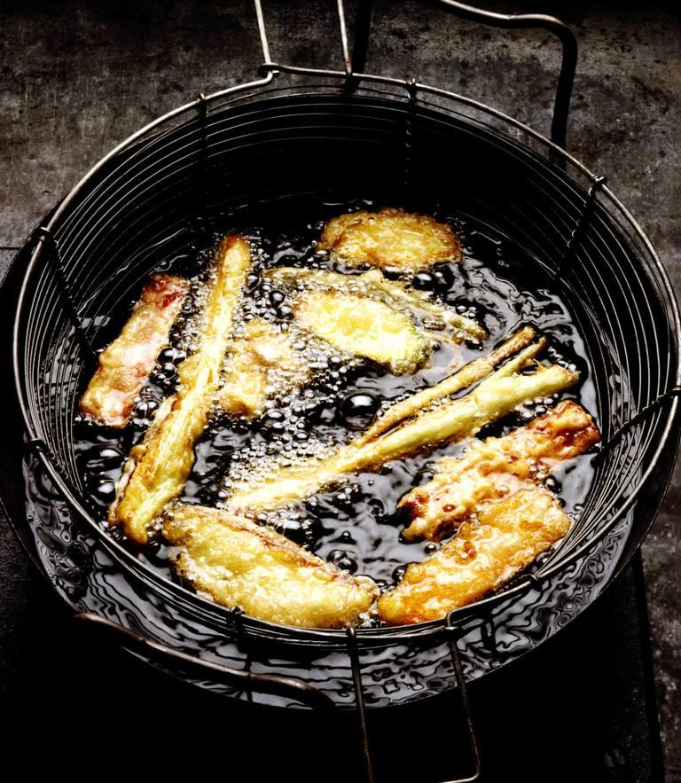 Vegetable tempura in deep fryer