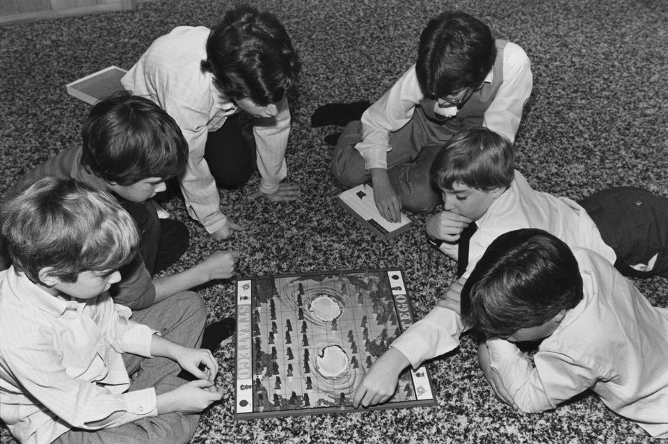 12 and 13-year-old boys playing the board game Stratego, December 1983.
