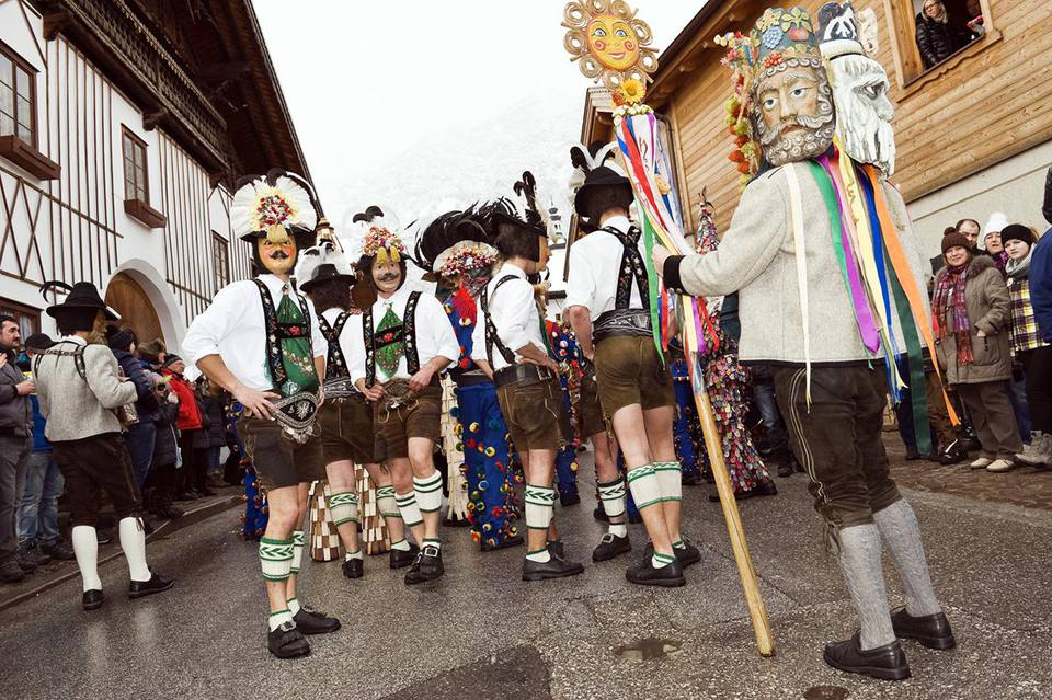 Carnival (Fasching) parade in Thaur, the men presenting the for seasons of the year, Tirol, Austria.
