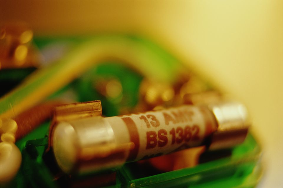 Inside of electrical plug, close-up (focus on 13 amp fuse)