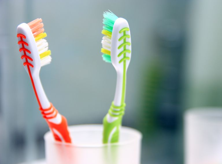 Two toothbrushes in the glass