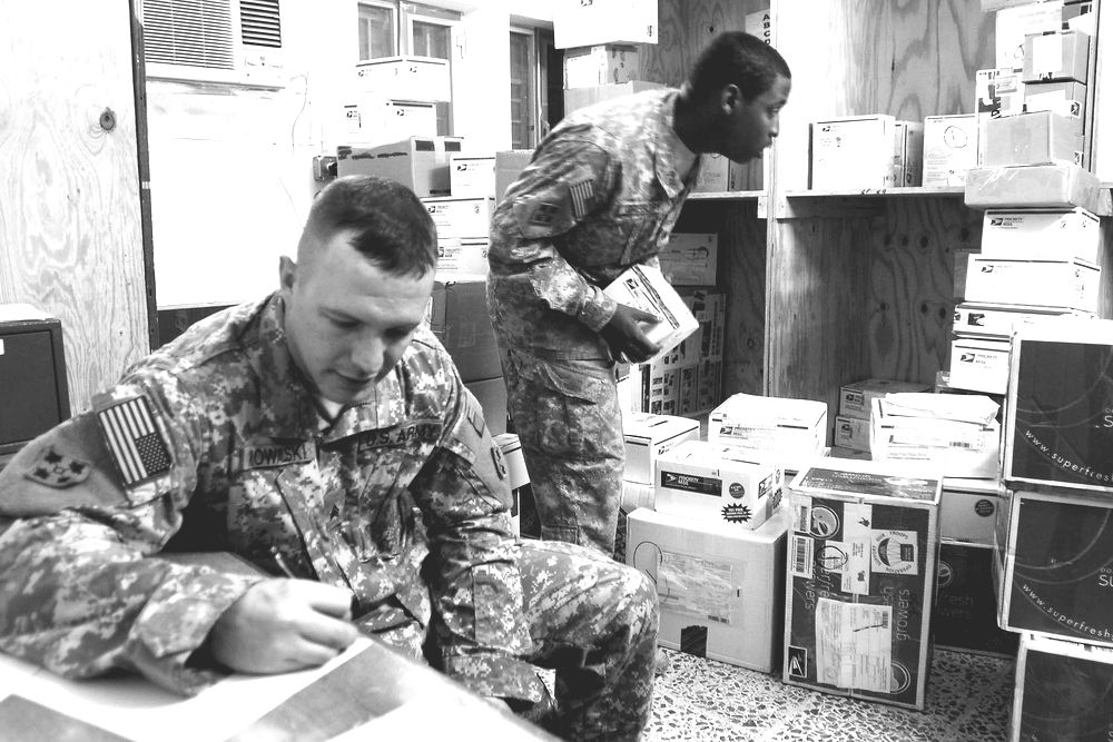 FORWARD OPERATING BASE FALCON, Iraq – Sgt. Charles Kowalski, a native of Bristol, Conn., makes a list of mail recipients to post outside the Headquarters Mail Room