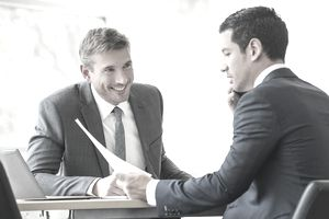 Two accountants at a desk