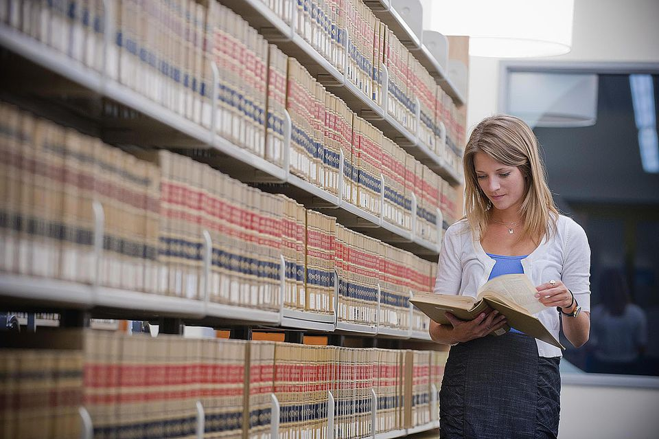 Young businesswoman in law library