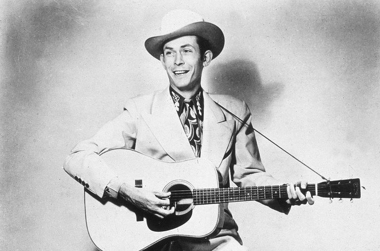 American country singer and songwriter Hank Williams holding a guitar, 1940s.