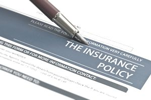 Insurance policy review form with pen.