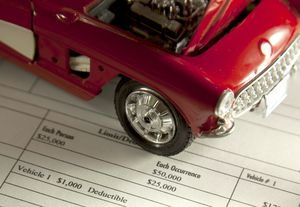 Toy care over car insurance paperwork