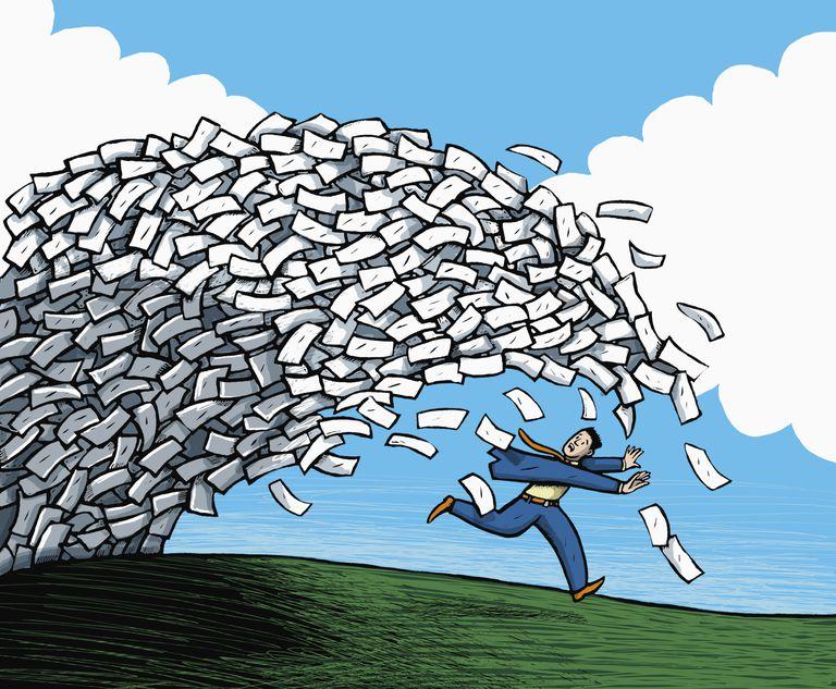 Man running from tsunami of bills