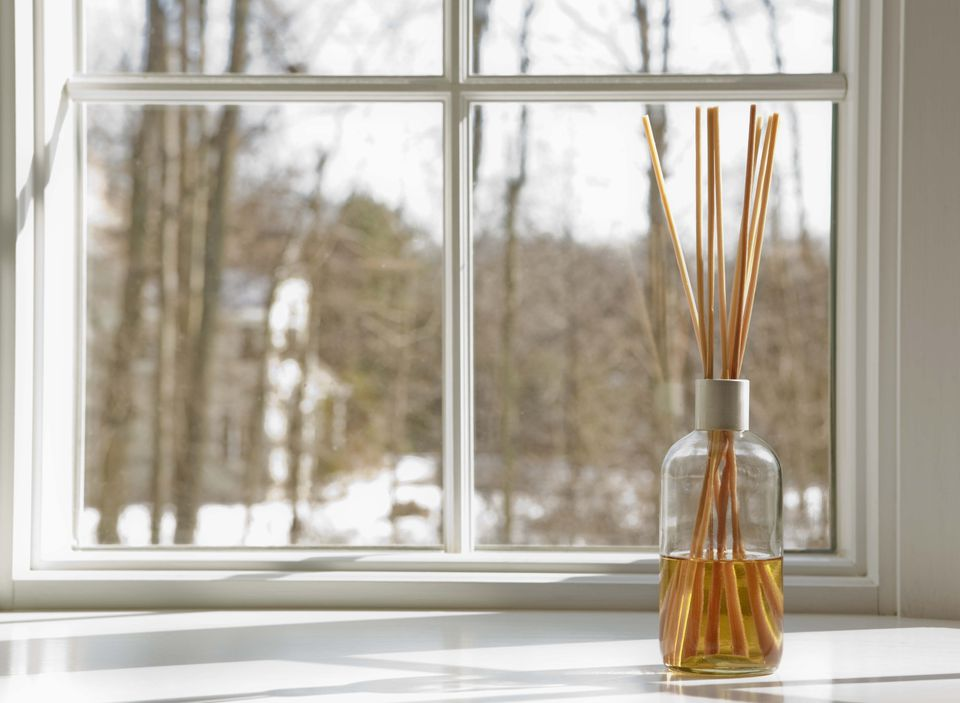 Aromatherapy reed diffuser by window