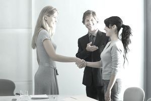 Business professionals meeting a new colleague