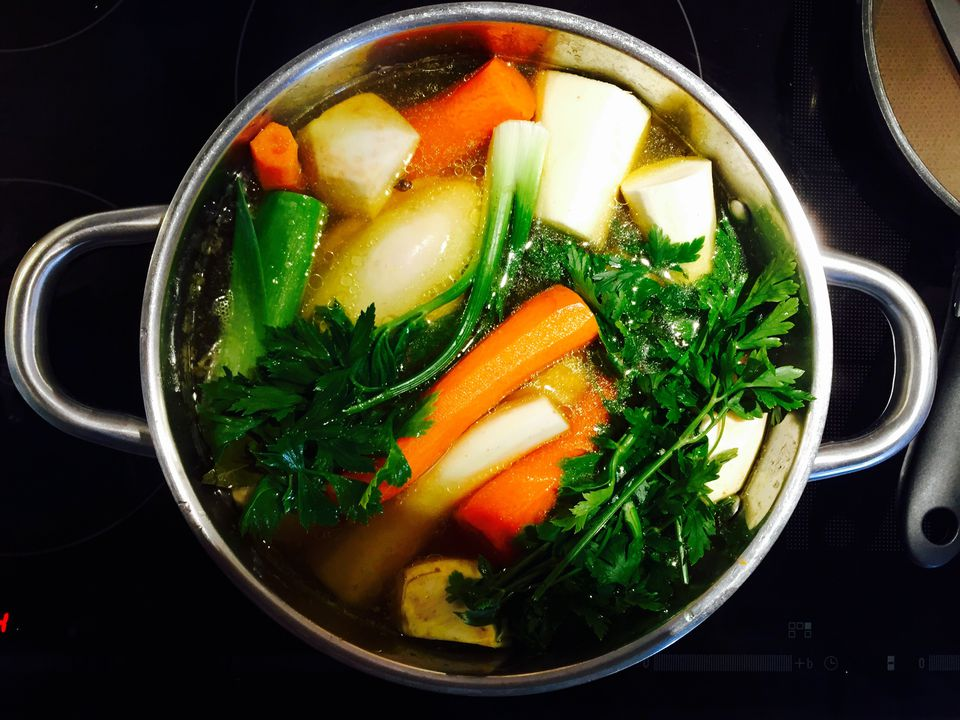 High Angle View Of Vegetables Boiling In Container