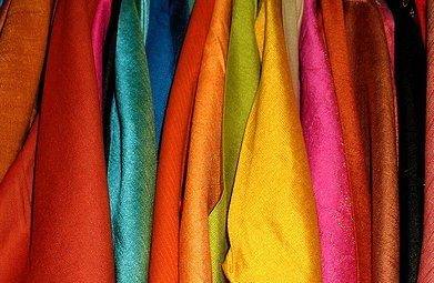 Colorful silks on display in India; the fabric was invented in China c. 4,000 B.C.