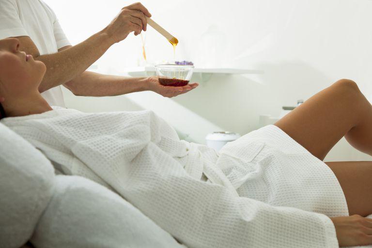 Woman at a waxing treatment