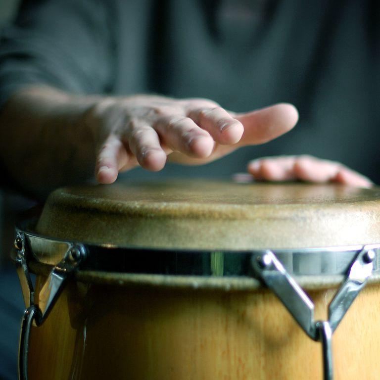 Man Playing A Drum