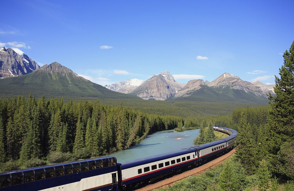 The Rocky Mountaineer tourist passenger train at Morant's Curve on the CPR line along the Bow River near Lake Louise in Banff National Park, Alberta, Canada.