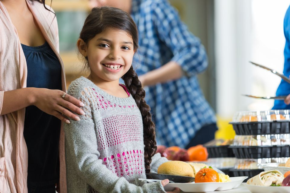 Young girl getting a meal at a food bank