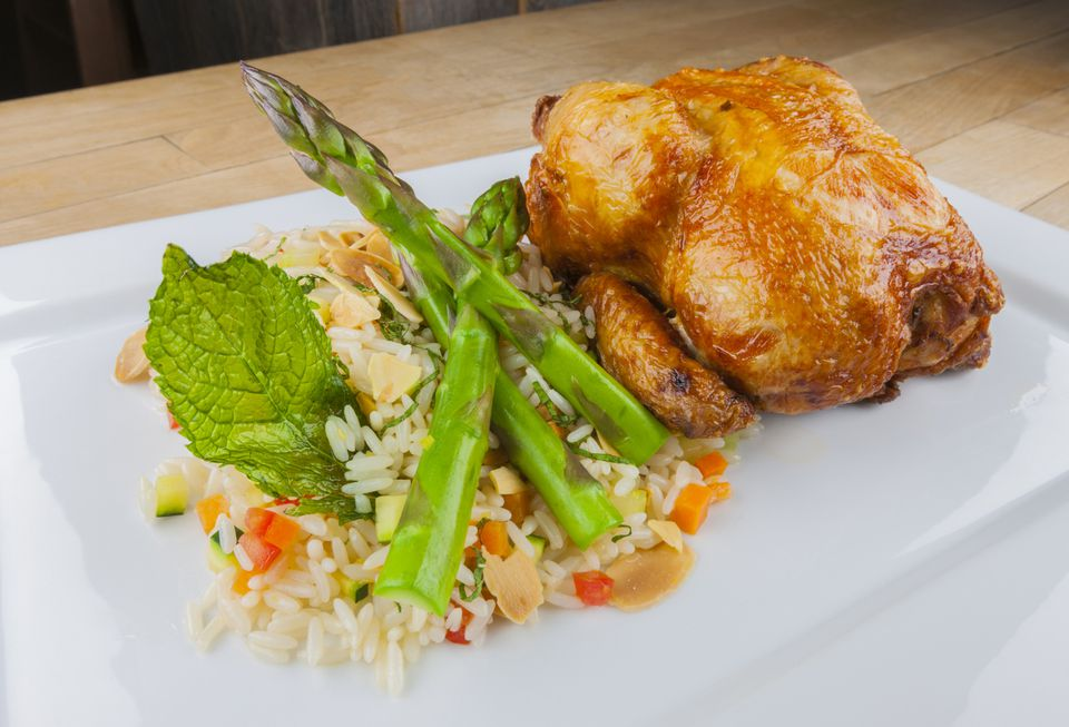 Cornish game hen with rice and asparagus