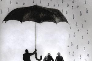 Businessman holding umbrella protecting elderly couple