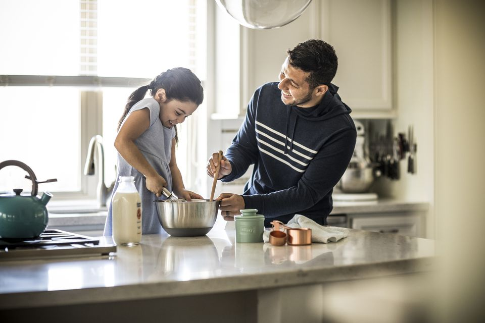Dad cooking with daughter