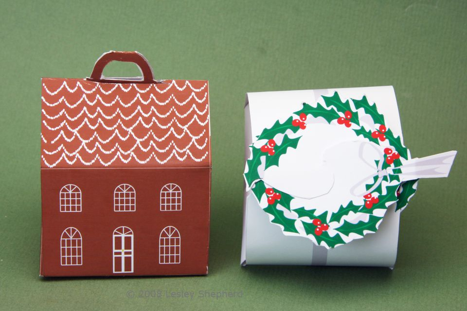 A printable miniature holly wreath topped box with silver ribbon and a gingerbread house shaped box.