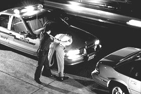 Policeman arresting suspect