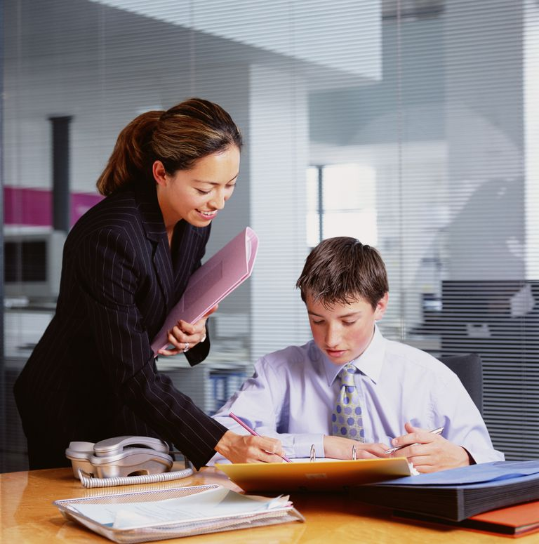 woman and young intern in office