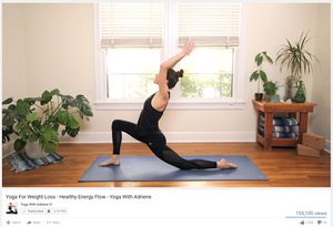 A woman doing a crescent moon pose