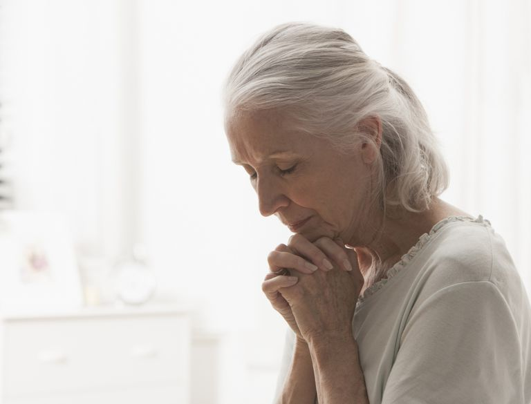 Woman with Dementia in Prayer