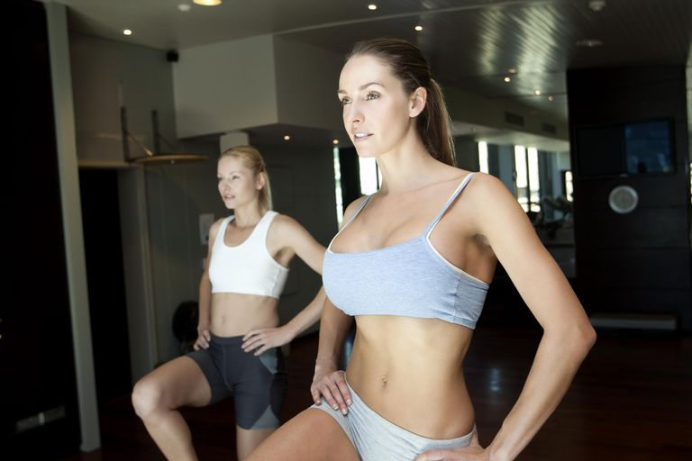 Two women exercising in gym