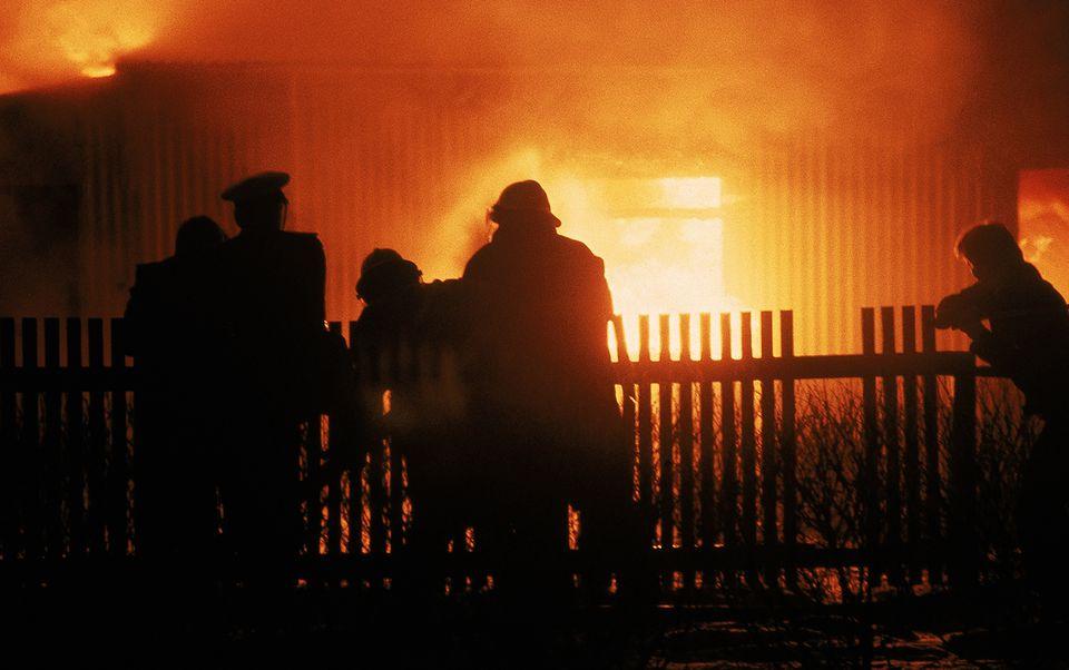 Fireman battling a house fire