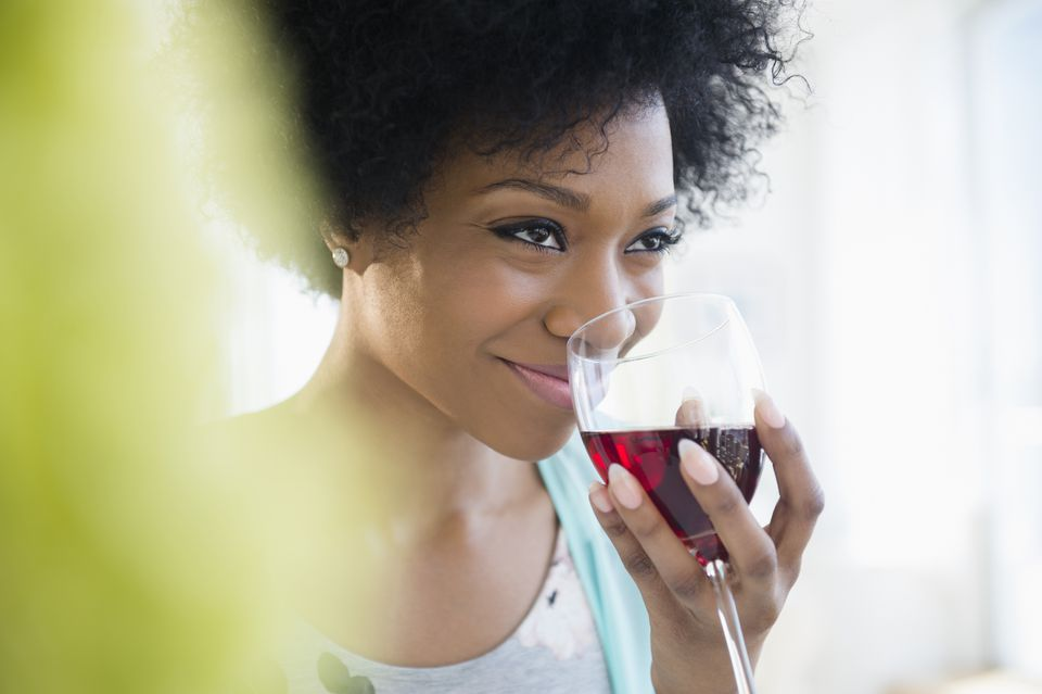 African American woman drinking glass of wine