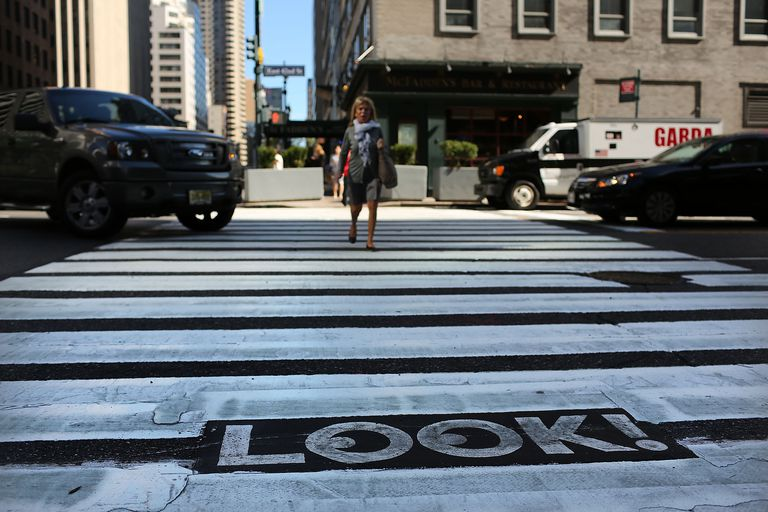 NYC Street Crossing with Look Sign