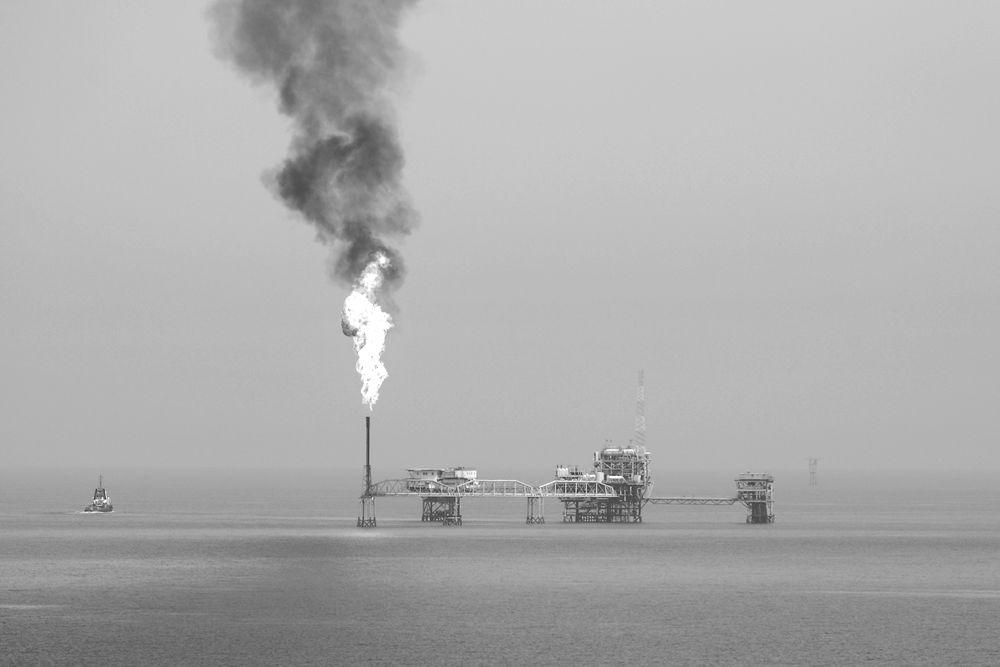 Burning gas in oil field in Gulf Sea.