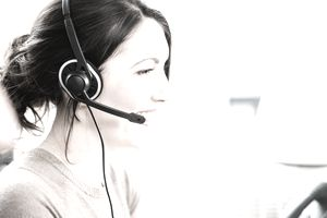 Telephonist wearing telephone headset