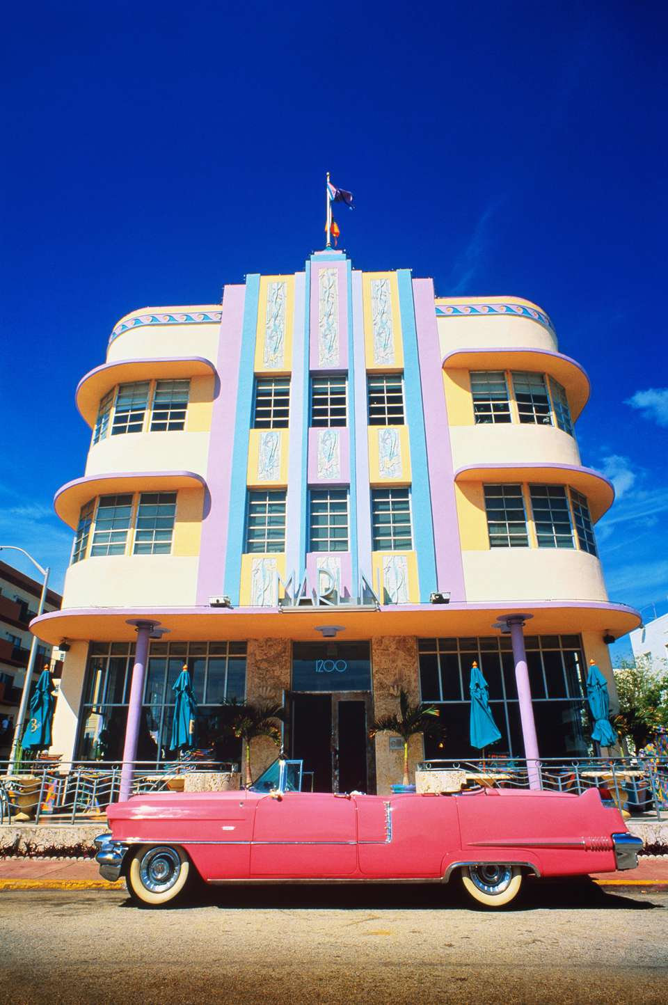 USA,Florida,Miami Beach,Art deco building,pink vintage car in fore
