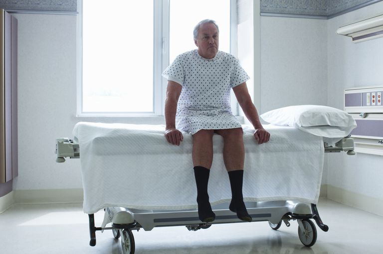 senior man in hospital gown