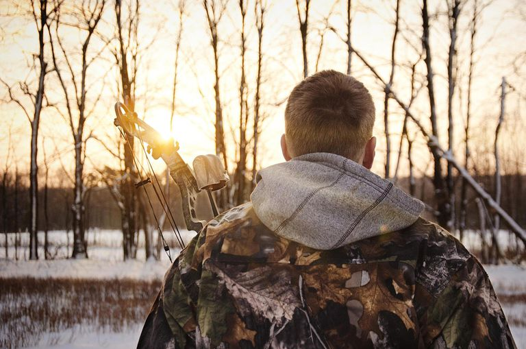 Crossbow Hunter in Camouflage at Sunset