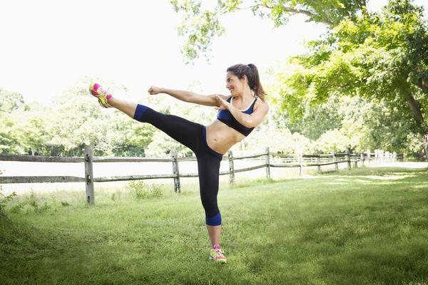 Woman doing side kick