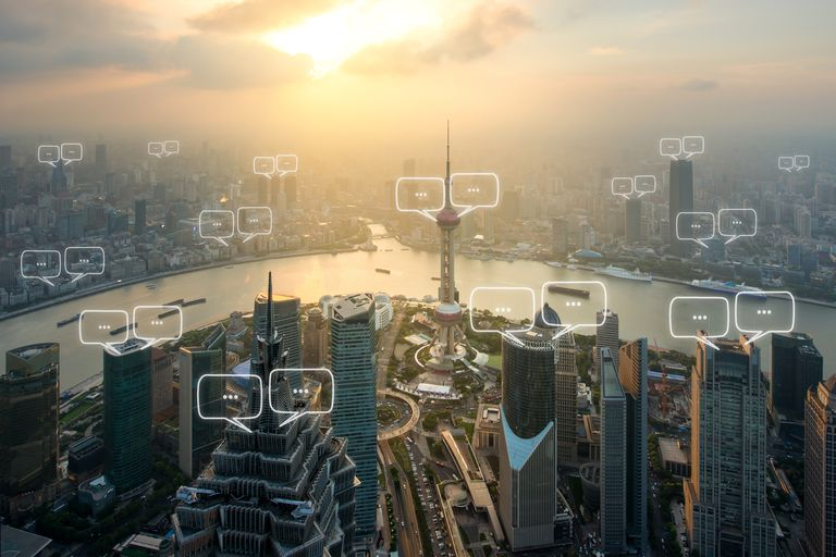 Text bubbles over city skyline.