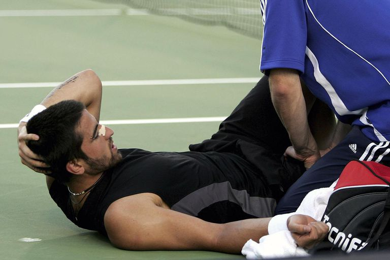 Janko Tipsarevic of Serbia receives treatment to a groin strain during his match with Lleyton Hewitt of Australia on day three of the Next Generation Adelaide International 2007 at Memorial Drive on January 2, 2007 in Adelaide, Australia