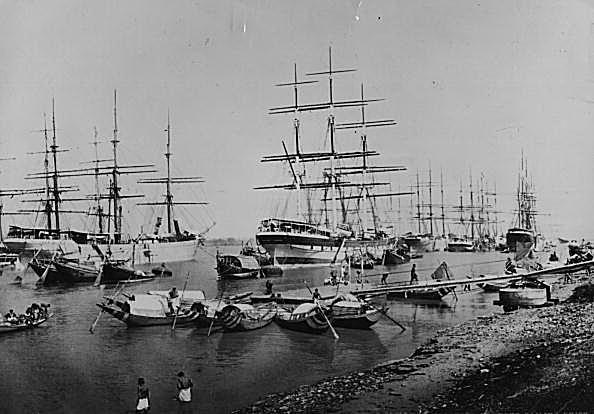British merchant ships in Calcutta Harbor, probably loading cotton, silks, and spices.
